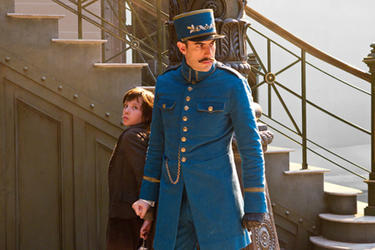 Asa Butterfield as Hugo Cabret and Sacha Baron Cohen as Station inspector in &quot;Hugo.&#39;&#39;